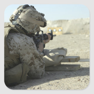 A Marine fires a M16A2 service rifle Square Sticker