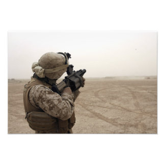 A Marine fires the M-32 Photographic Print