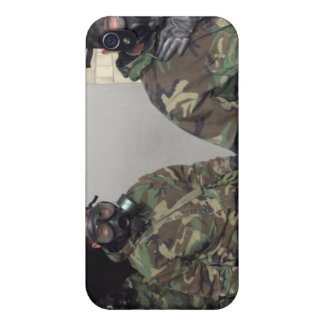 A Marine holds his chest displaying relief iPhone 4/4S Cases