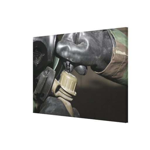 A Marine inserts a drinking tube into his cante Stretched Canvas Prints