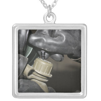 A Marine inserts a drinking tube into his cante Square Pendant Necklace