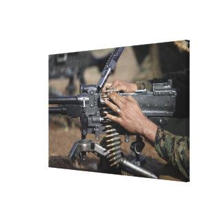 A Marine loads a M-240G machine gun Stretched Canvas Prints