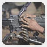 A Marine loads a M-240G machine gun Square Stickers