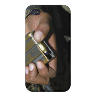 A Marine loads blank ammunition rounds iPhone 4 Cases