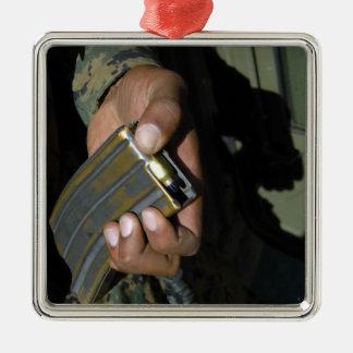 A Marine loads blank ammunition rounds Metal Ornament