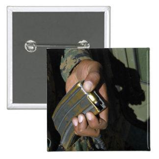 A Marine loads blank ammunition rounds Pinback Button