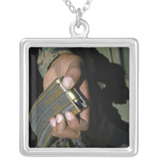 A Marine loads blank ammunition rounds Silver Plated Necklace