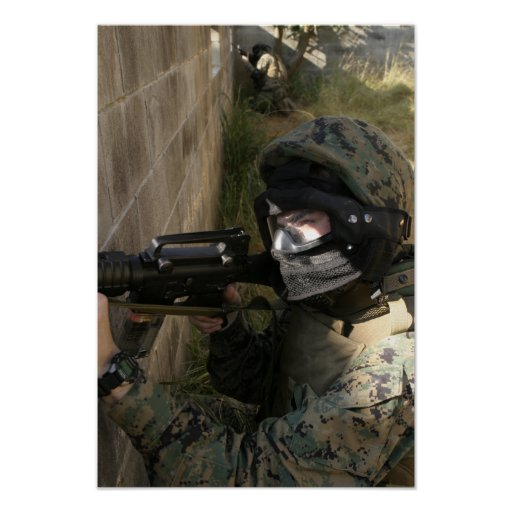 A Marine provides security Poster