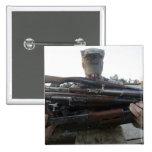 A marine readies 80 pounds of enemy rifles seiz pinback button