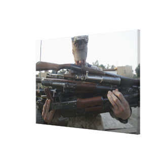 A marine readies 80 pounds of enemy rifles seiz gallery wrap canvas