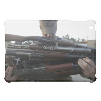 A marine readies 80 pounds of enemy rifles seiz cover for the iPad mini