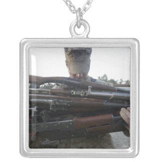 A marine readies 80 pounds of enemy rifles seiz custom necklace