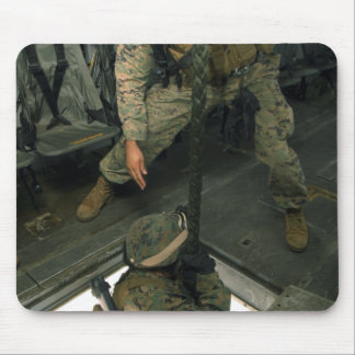 A Marine sends a fellow Marine down the hell ho Mouse Pad