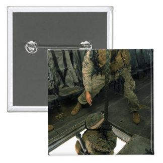 A Marine sends a fellow Marine down the hell ho Pinback Button