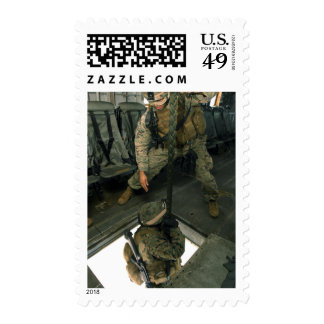 A Marine sends a fellow Marine down the hell ho Postage Stamps