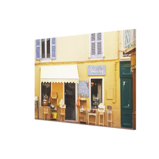 A market street in the old town with a shop canvas print