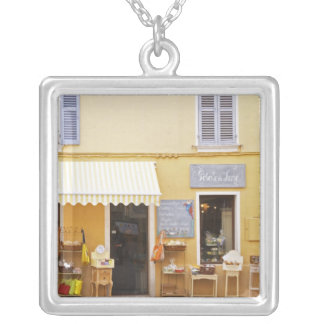 A market street in the old town with a shop square pendant necklace