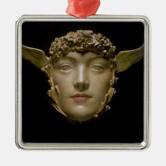 A Mask, c.1897 Metal Ornament