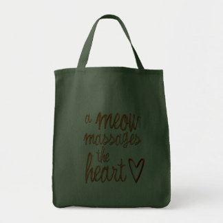 A meow massages the heart. tote bags