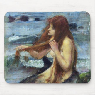 A Mermaid study Mouse Pads