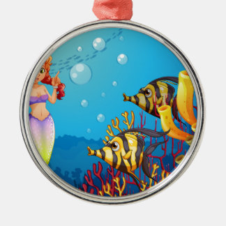 A mermaid watching the two fishes round metal christmas ornament