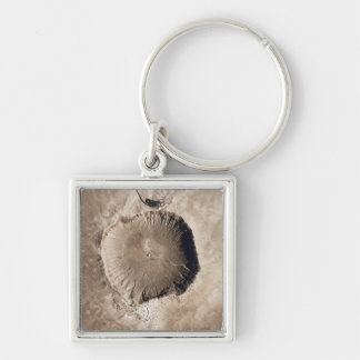 A meteorite impact crater keychain