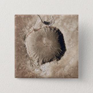 A meteorite impact crater pinback button