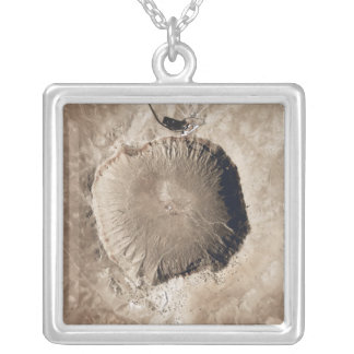 A meteorite impact crater silver plated necklace