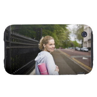 A mid adult woman carrying a yoga mat, walking iPhone 3 tough case