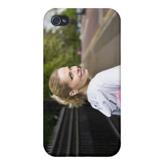 A mid adult woman carrying a yoga mat, walking cover for iPhone 4