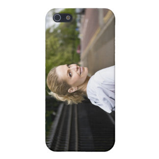 A mid adult woman carrying a yoga mat, walking cover for iPhone 5