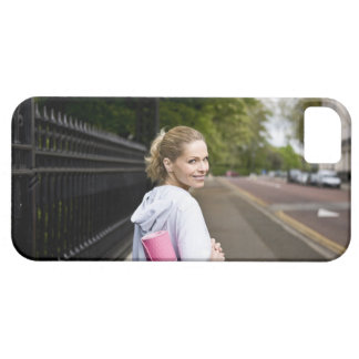 A mid adult woman carrying a yoga mat, walking iPhone SE/5/5s case