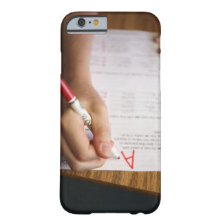A middle school teacher puts a grade on a barely there iPhone 6 case