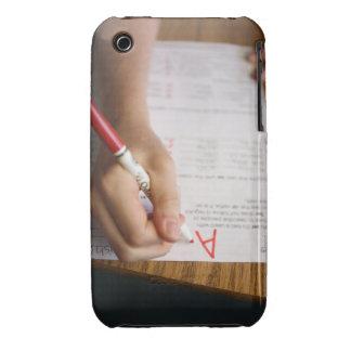 A middle school teacher puts a grade on a iPhone 3 case