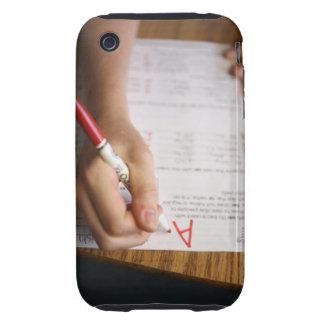 A middle school teacher puts a grade on a iPhone 3 tough cover