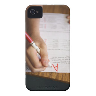 A middle school teacher puts a grade on a iPhone 4 case