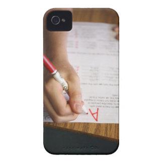 A middle school teacher puts a grade on a iPhone 4 case