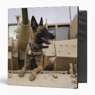 A military working dog sits on a US Army M2A3 Binder