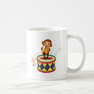 A monkey above a drum with cymbals basic white mug
