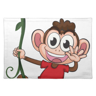 A monkey hanging on a plant cloth place mat
