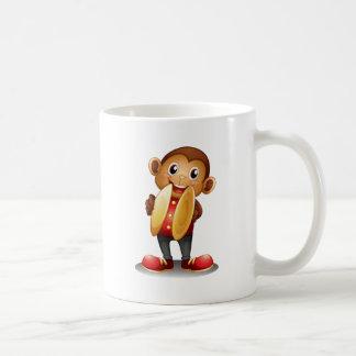 A monkey holding cymbals basic white mug