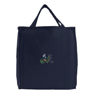 A monogram floral butterfly embroidered tote bag