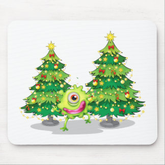 A monster dancing in front of the christmas trees mouse pad