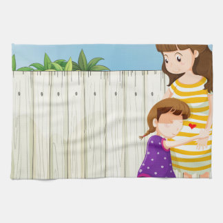 A mother and her daughter near the fence at the ro towel