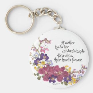 A Mother holds a child's heart Basic Round Button Keychain