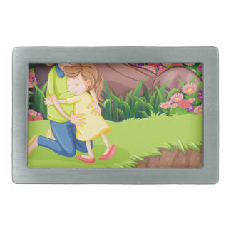A mother hugging her daughter at the riverbank belt buckle