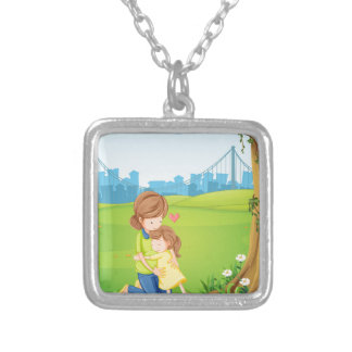 A mother hugging her daughter under the tree silver plated necklace