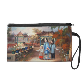 A mother with her children in a chinese garden, c. wristlet
