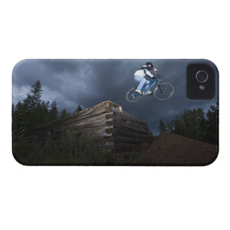 A mountain biker jumps off a log cabin in Idaho. iPhone 4 Case