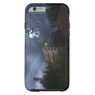 A mountain biker jumps off a log cabin in Idaho. Tough iPhone 6 Case